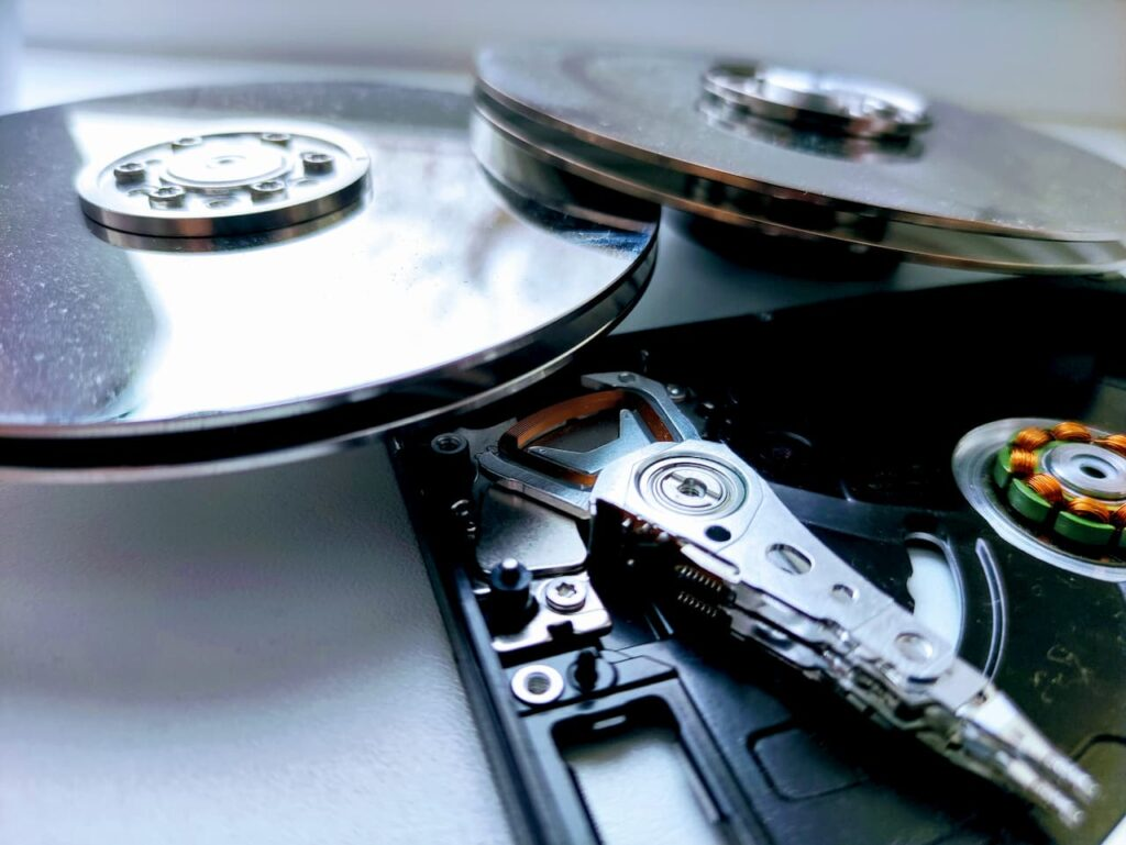 Platinum coated platters and the frame of hdd disks taken apart